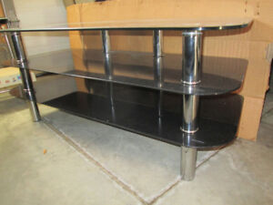 Three level glass TV stand for sale-$50.00 frim.