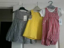 Girls dresses 6-9 months never worn