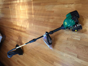 Weed Eater gas powered grass trimmer - brand new