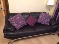 Two Black leather sofas