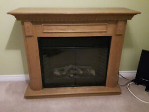 Fireplace mantel with electric insert.