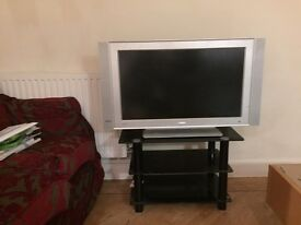 TV AND HIGH QUALITY STAND £40 ONO