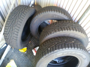 14 inch snow tires practically brand new use one season
