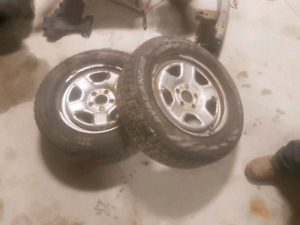Pair of 5 bolt rims and tires