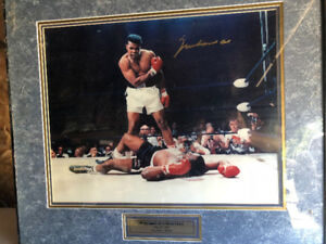 Muhammad Ali autographed picture with frame