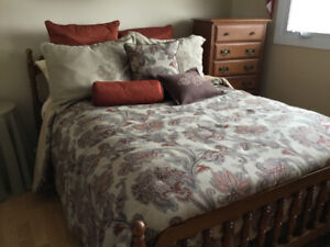 Beautiful bedspread,  bed skirt and decorator pillows.