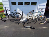 2 CCM Electric Powered Bicycles w/ Bike Rack, Cover, 3 Batteries