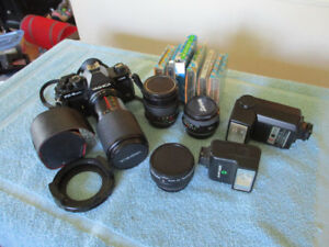 35 MM Camera with lenses and extras