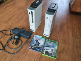 2 Xbox 360, 2 120gb hard drives with 1 power supply and 2 games