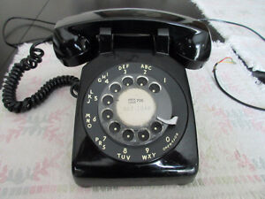 Vintage rotary black phone from the 60s