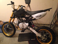 like new black and gold 125cc dirtbike