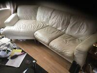 White leather angled sofa