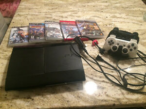 PS3 super slim with uncharted games and 2 controllers