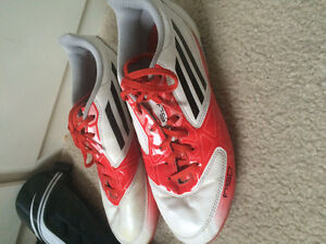 Soccer cleats and shin guards size 7 women like new