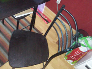 4 piece metal table and chair set. 5 years old