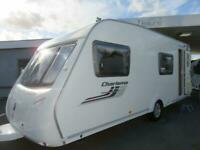 2011 SWIFT CHARISMA 570 6 BERTH CARAVAN WITH SIDE DINETTE AND FIXED BUNK BEDS..