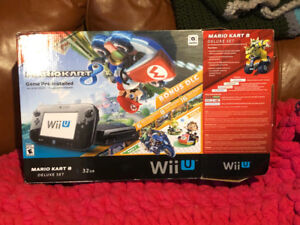 Wii U console with 4 games. Perfect working condition.