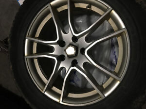 Four Toyo winter tires with alloy rims