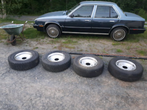 4 chev 8 bolt 16 inch rims with rubber