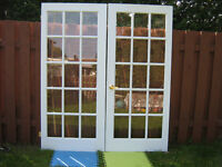 2  new  french  doors finish coated in  white