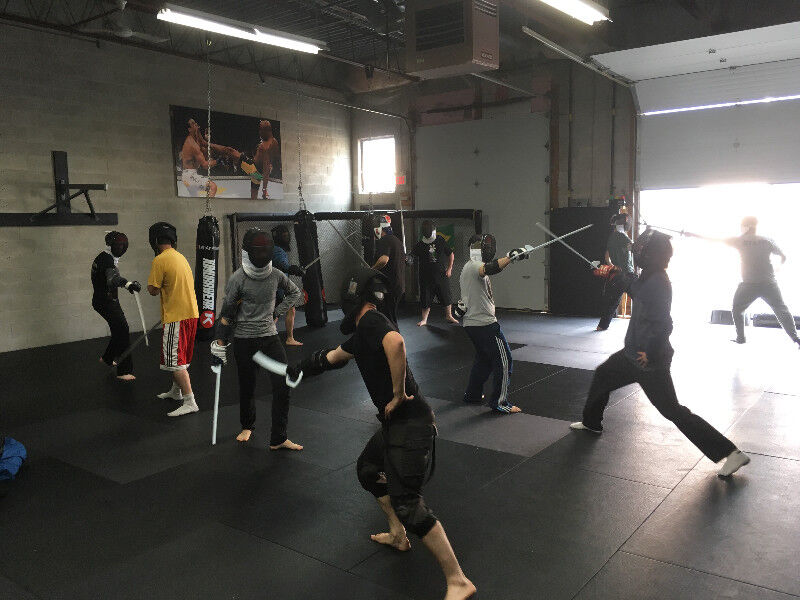 medieval sword fighting lessons classes sabre HEMA fencing
