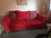Three seater red fabric sofa