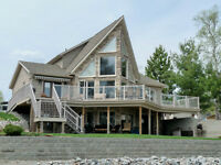 EXECUTIVE RIVERFRONT HOME! EXTREME QUALITY HOME & GARAGES!