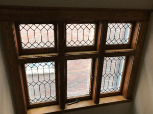 Vintage complete window casing with leaded windows