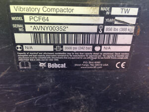 Bobcat plate compactor with JD QA