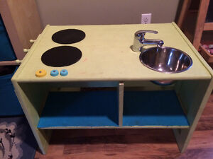 Wooden kitchen set, chalkboard, hooks, shelves, sink, ect.