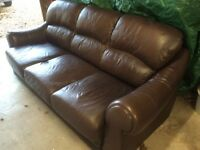 Three seater brown leather sofa