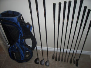 Golf clubs with a bag, balls and tees