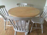 Round Pedestal Table with Four Chairs