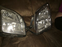 Stock OEM 2006-2009 Ford Fusion headlamps and bulbs ALL WORK!!