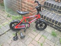 Small red BMX bike urban racers complete with stabilisers suit ages 3-5