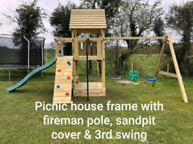 Wooden Climbing frame slide platform swings rock wall play park