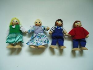 4 small wooden dollhouse dolls