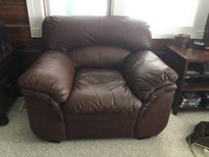 "Leather sofa, love seat, chair and 55""RCA tv..."