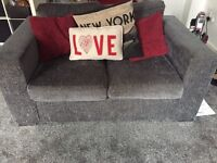 Grey sofas three and two seater 2 years old