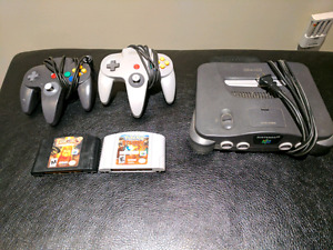 N64 with 2 controllers abd 2 games