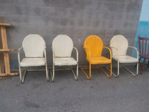 Four vintage metal lawn chairs