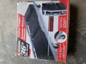 "Folding Creeper 36""(New in box, pick up in Milton)"