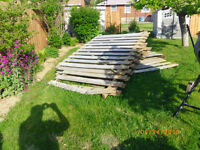 Approximately 75 feet of used wooden fence in 6-7 panels