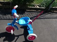 Trike - with a handle on the back. Plays two tunes.