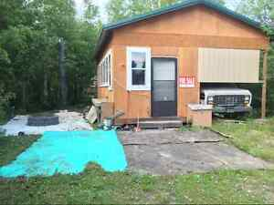 Camper and cabin on seasonal lot, Lot 83
