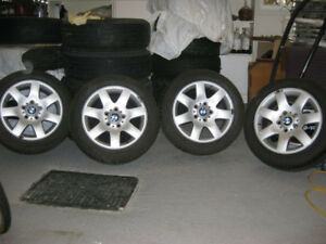 16 in. original BMW mags good condition, tires are no good