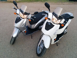 Two KYMCO People S 200 scooters for sale