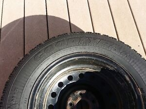 A set of Goodyear snow tires with rims 215/65R16