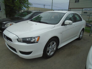 $9,995.00  2015 Mitibushi Lancer Se  4door Sedan