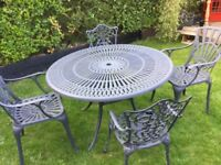 Garden table and chairs one arm missing